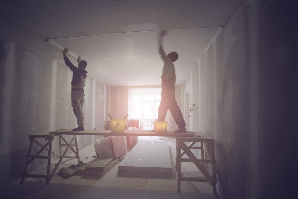 men renovating a home