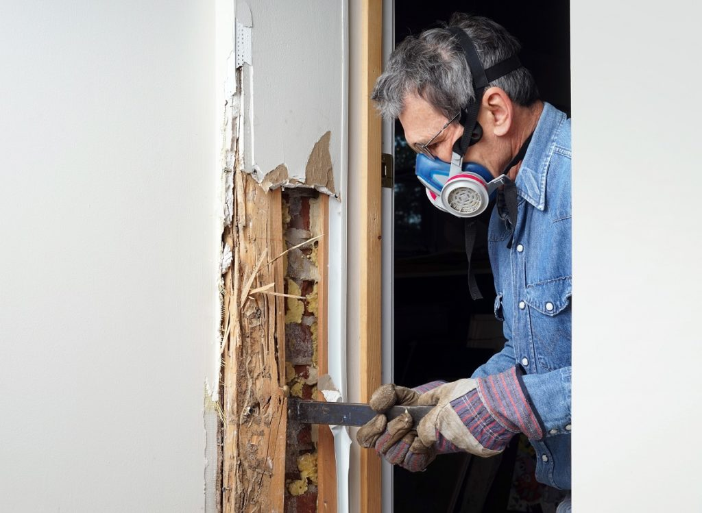 Man removing a wall