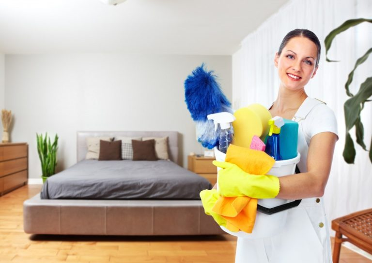 Female about to clean the house