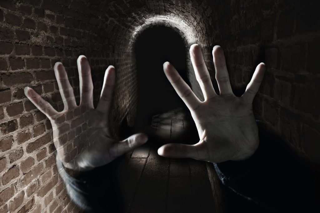 hands by the tunnel