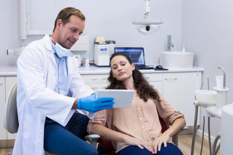 Dentist and female patient