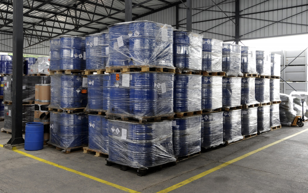 containers with labels in a warehouse