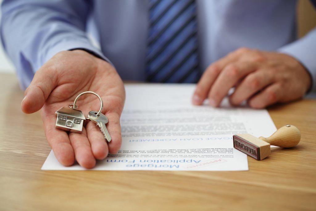 man holding a home key