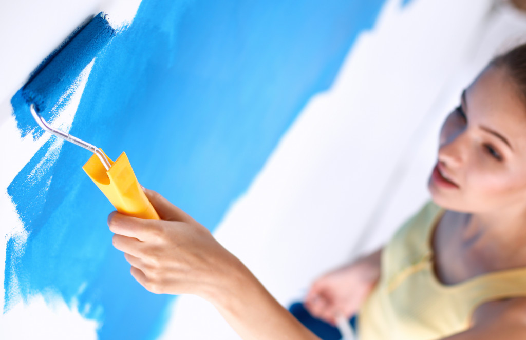Woman doing wall painting