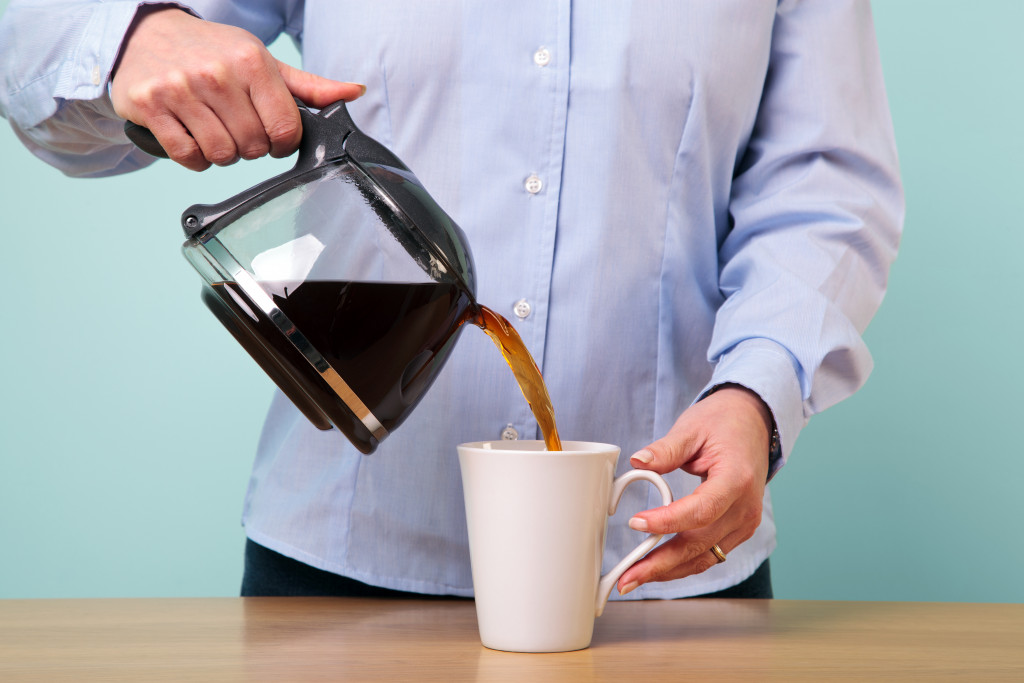 Man pouring cup of coffee