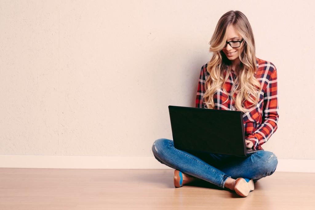 blogger sitting on the floor