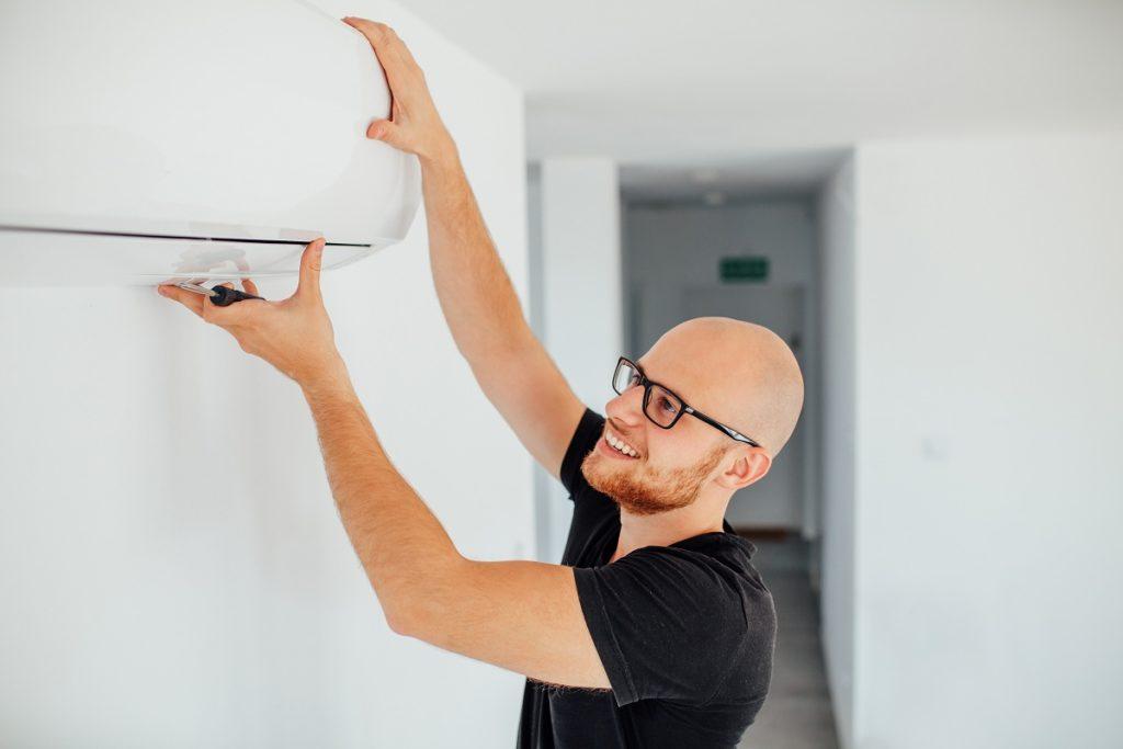 man fixing his aircon