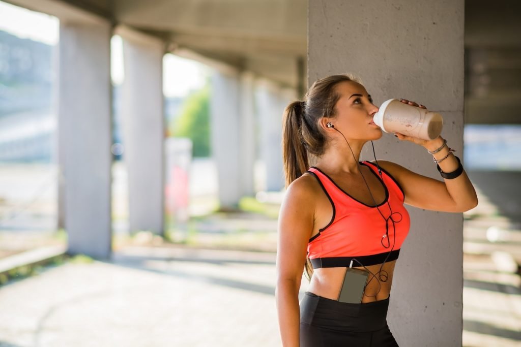 woman drinking after exercise
