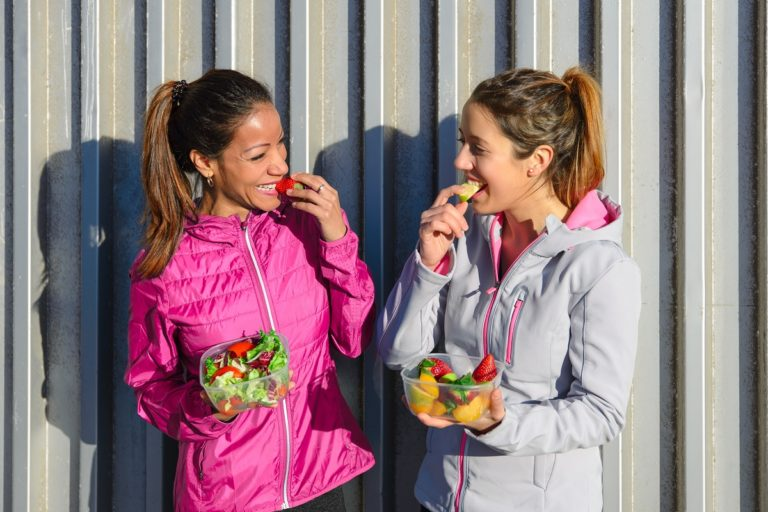 two women eating fruits
