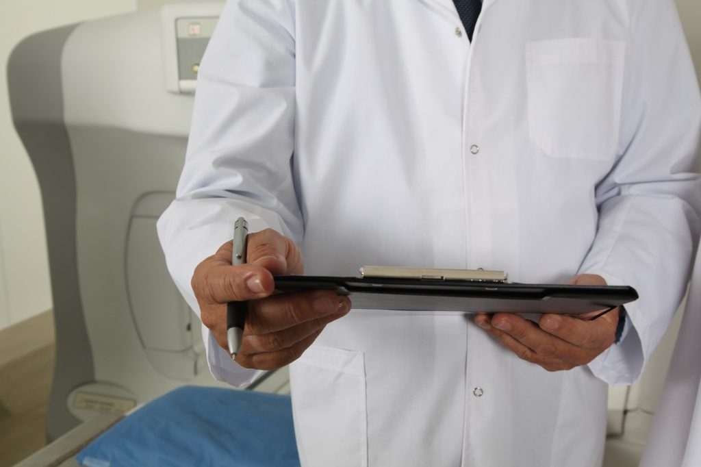 doctor holding test results