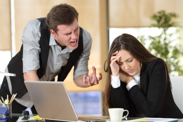 woman feeling stressed at her boss