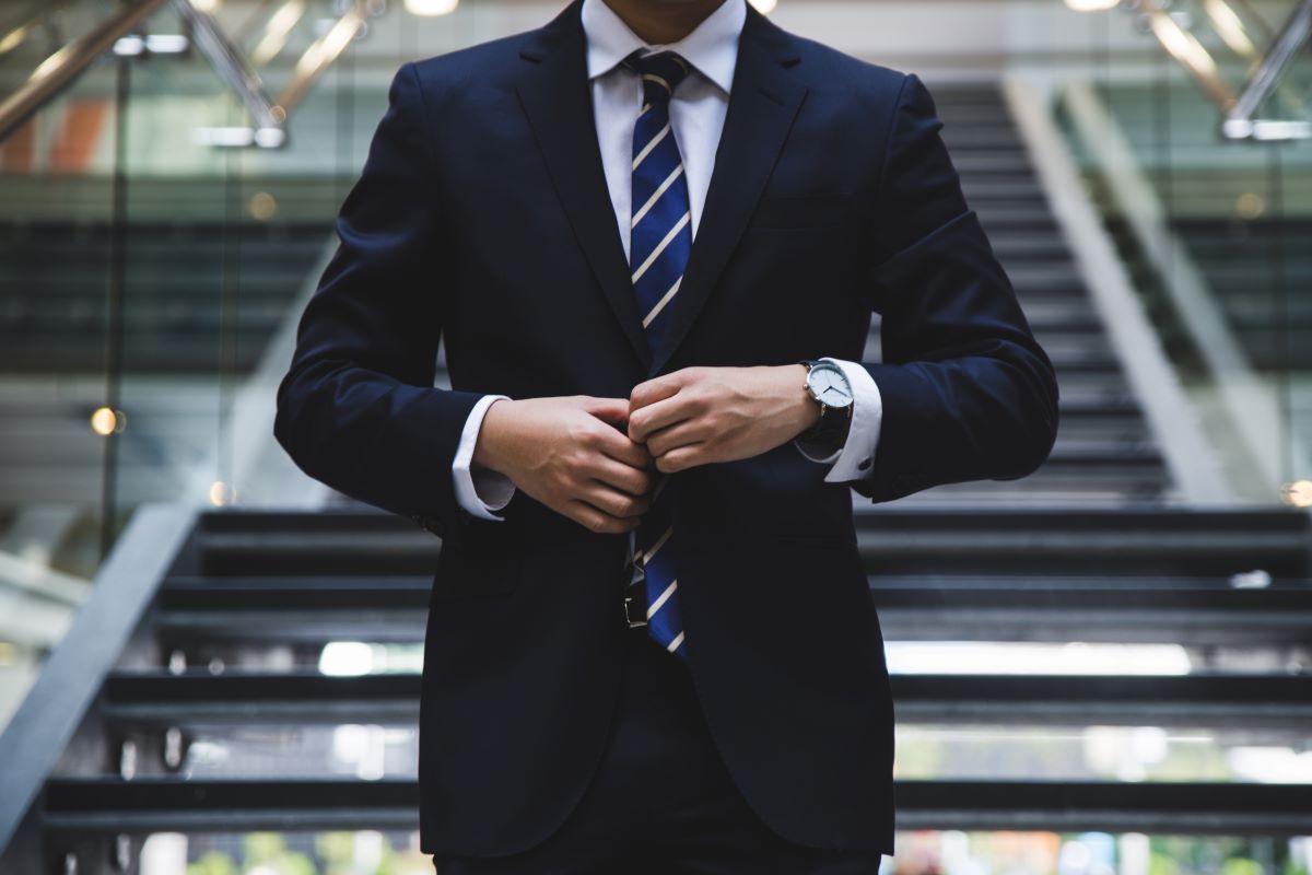 man wearing suit walking