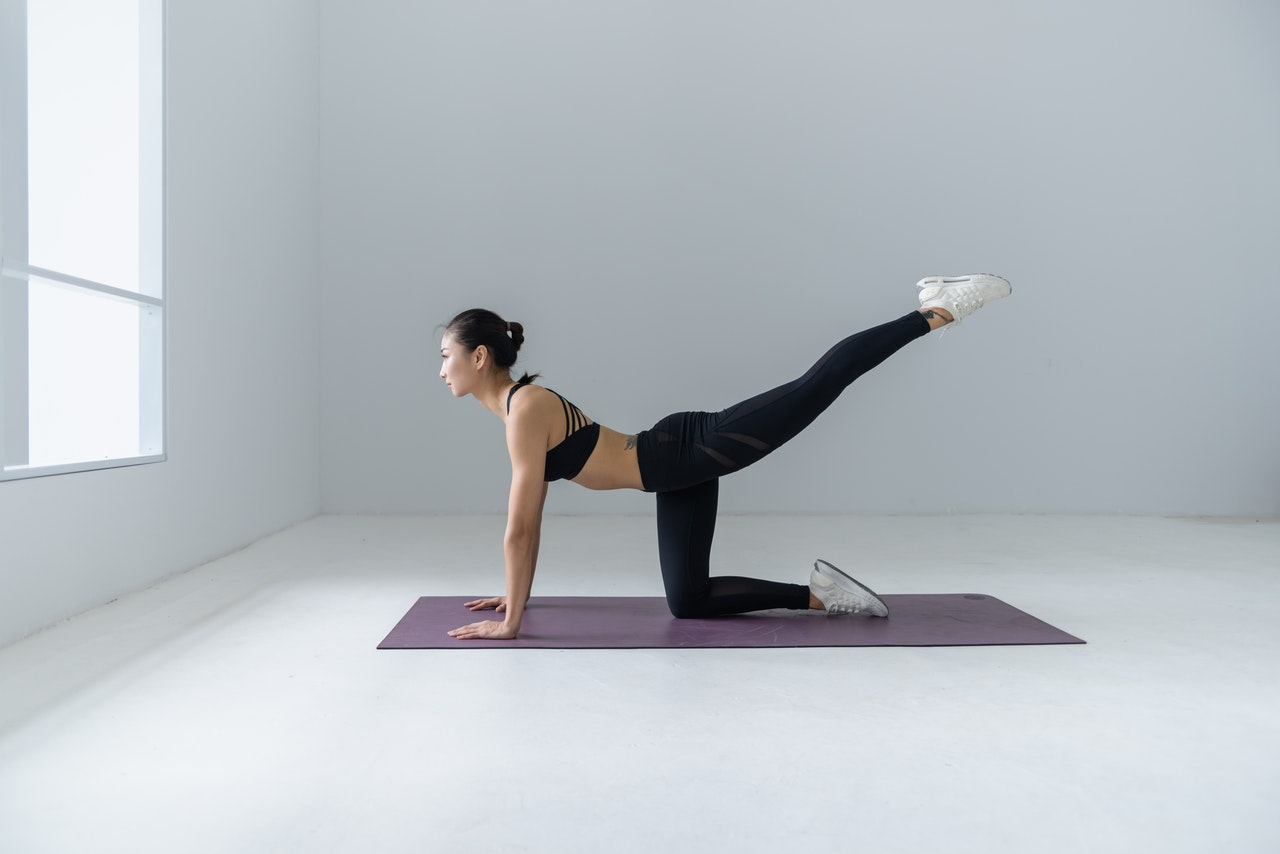 woman stretching practicing yoga