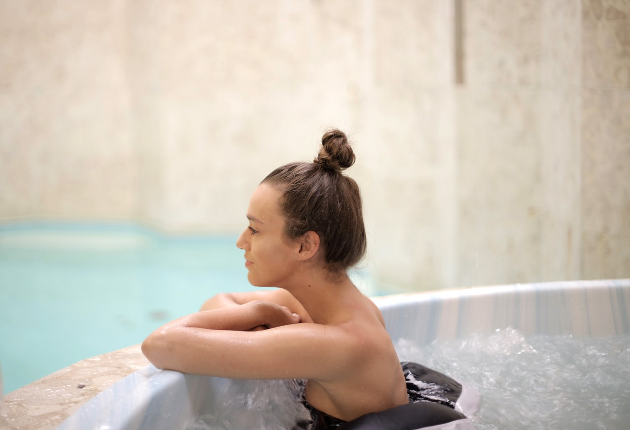 Woman taking a bath in a hot tub