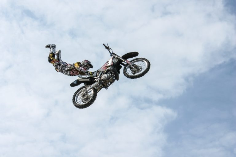 man in the air with his motorbike