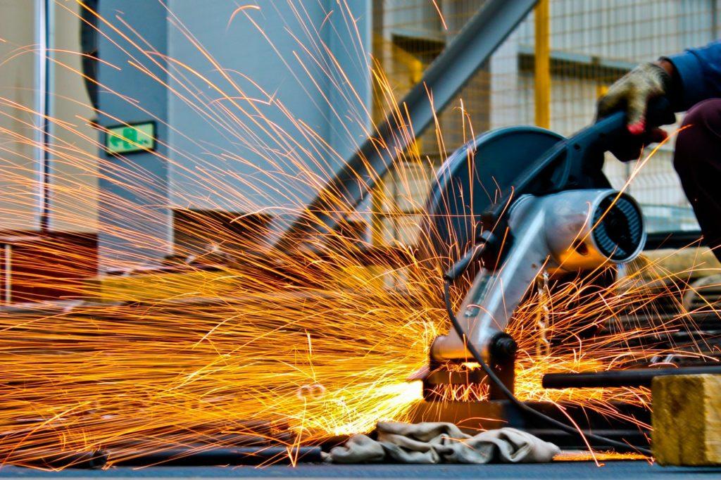 person cutting metal
