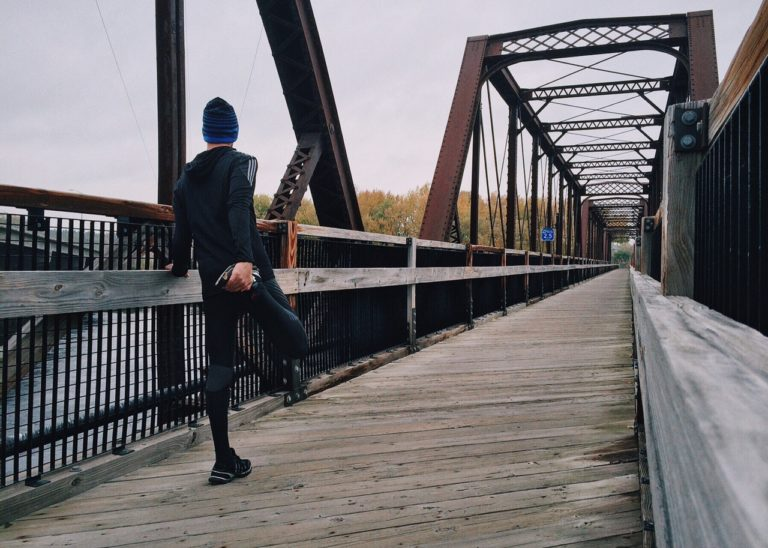 person jogging on a bridge