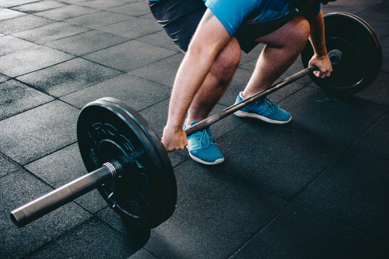 person lifting a barbell