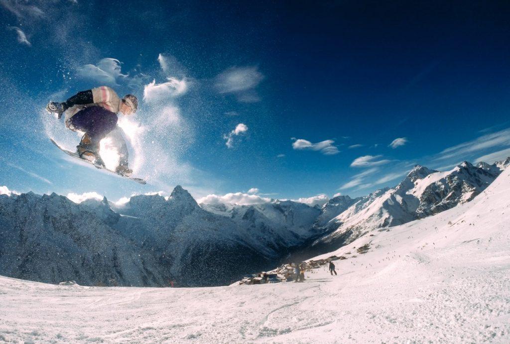 man snowboarding