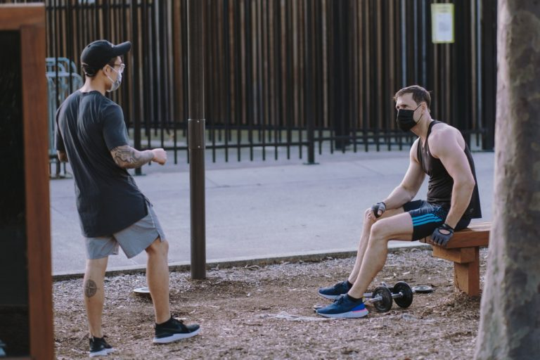 men working out at a park