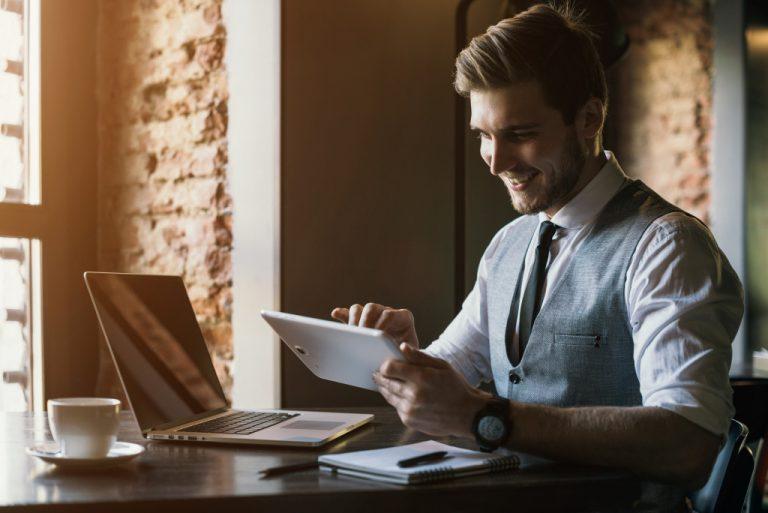 businessman using task management applications