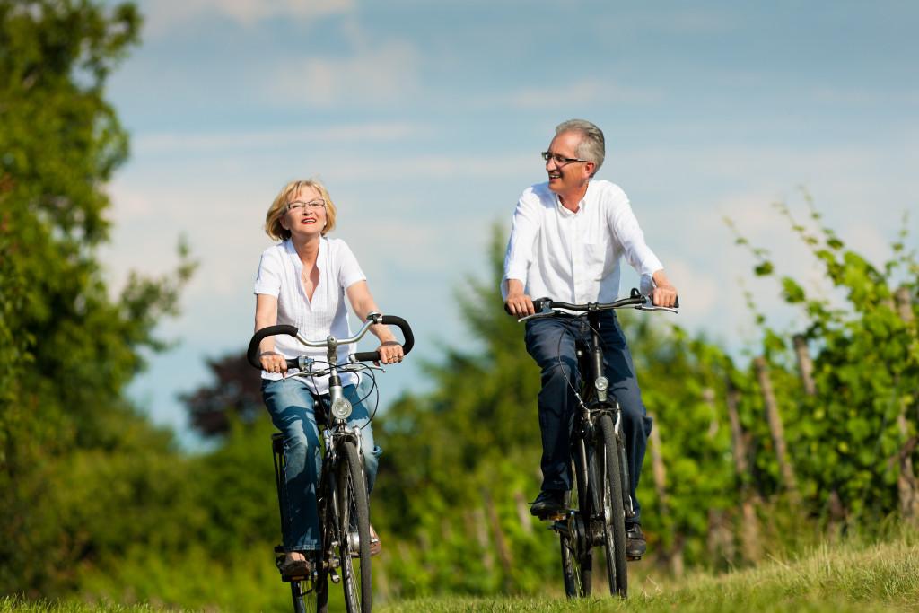 retired couple biking
