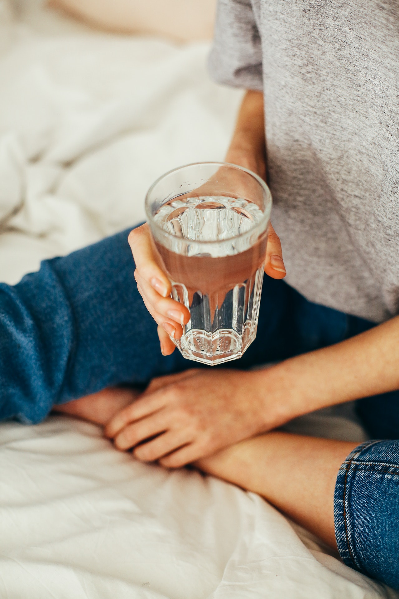 holding a glass of water
