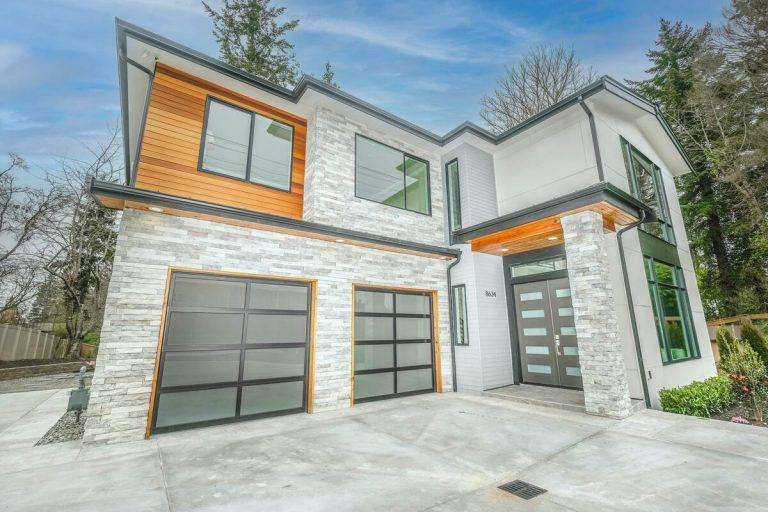 picture of a big house with garage