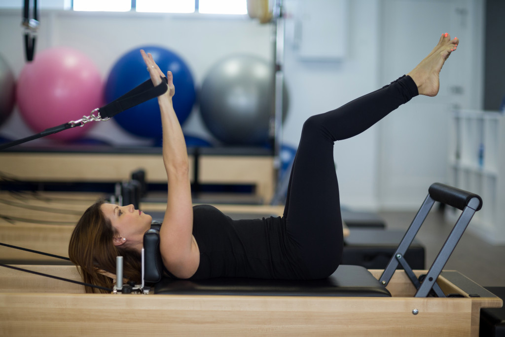 woman exercising at her home gym