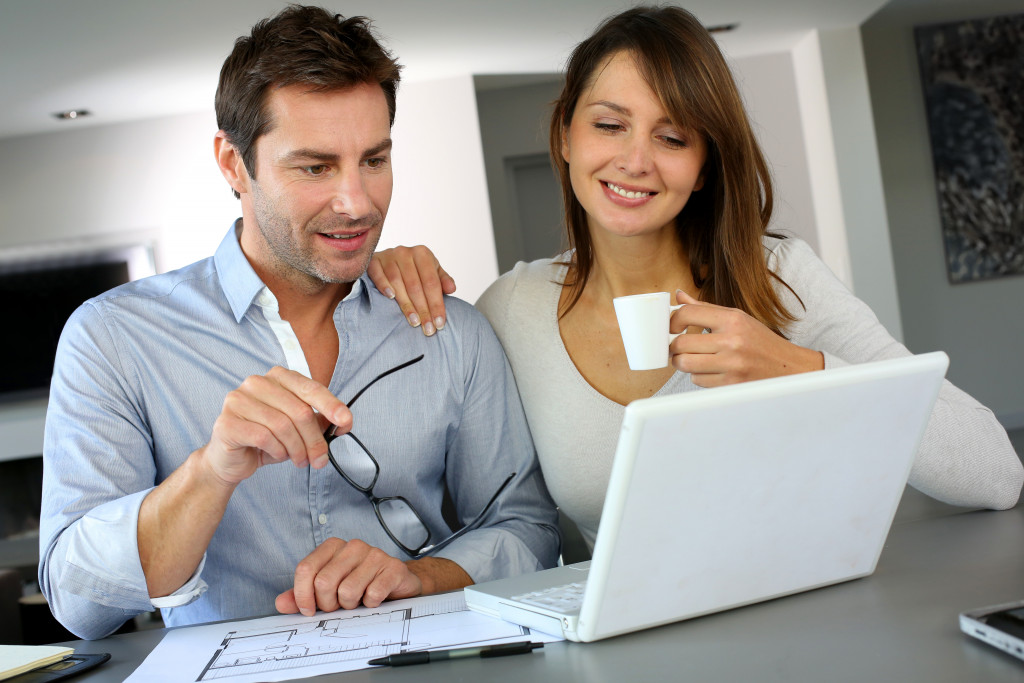 man and woman looking at house design
