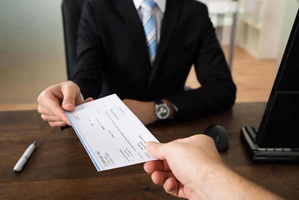 man receiving a check