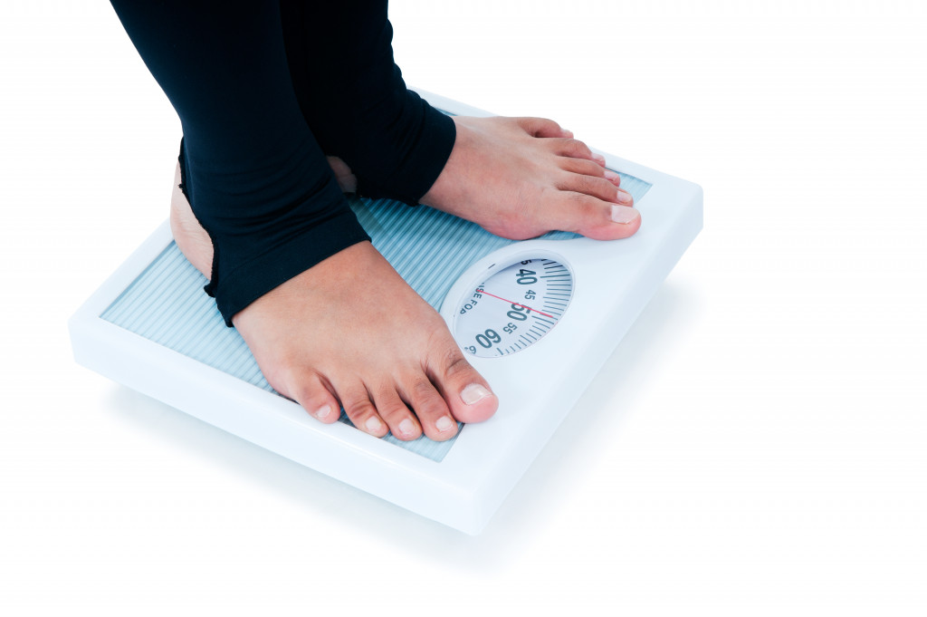 person on a weighing scale