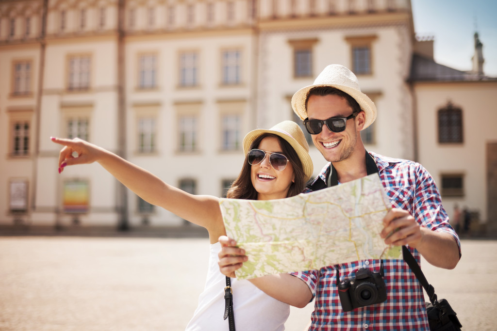 tourists holding map