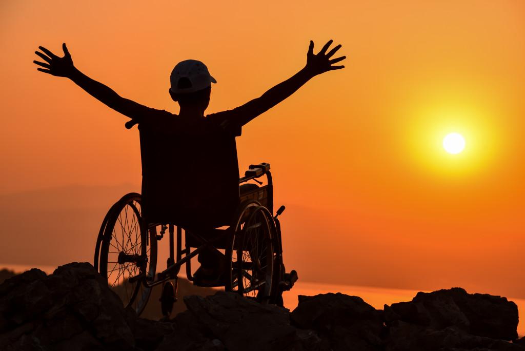 disabled man raising their arms