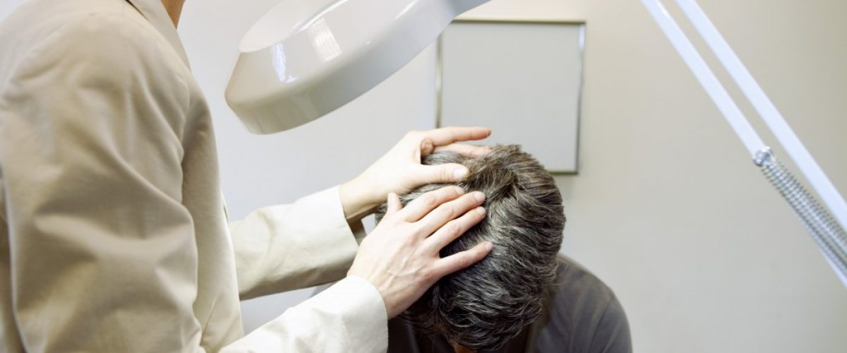 doctor checking a man's head