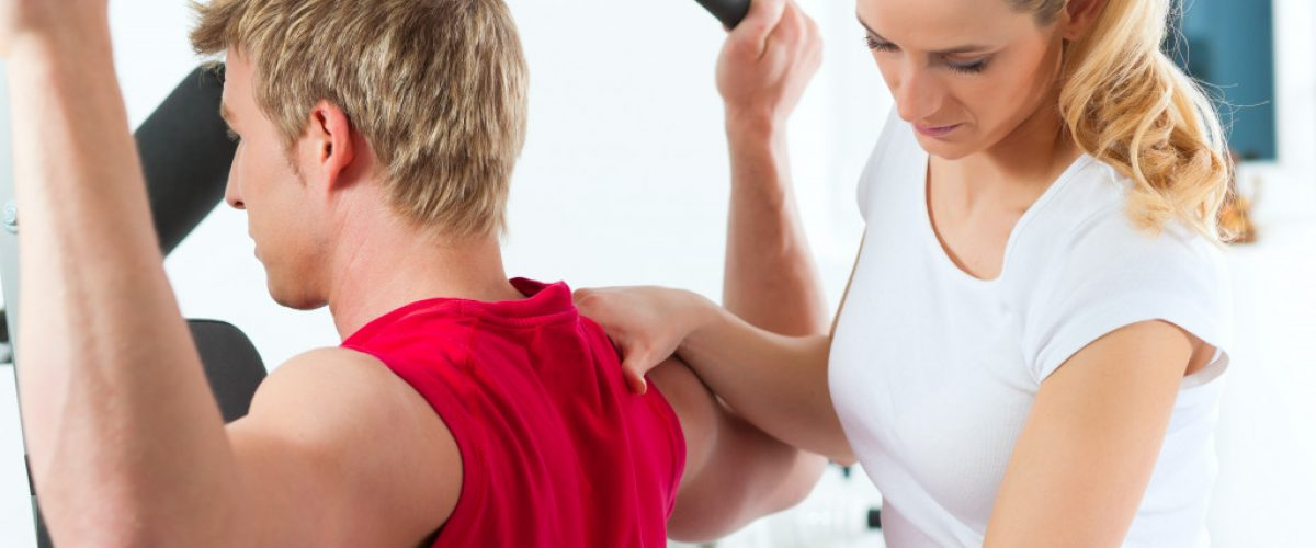 woman assisting a man exercising