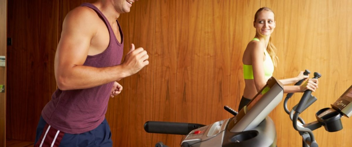 couple working out treadmill