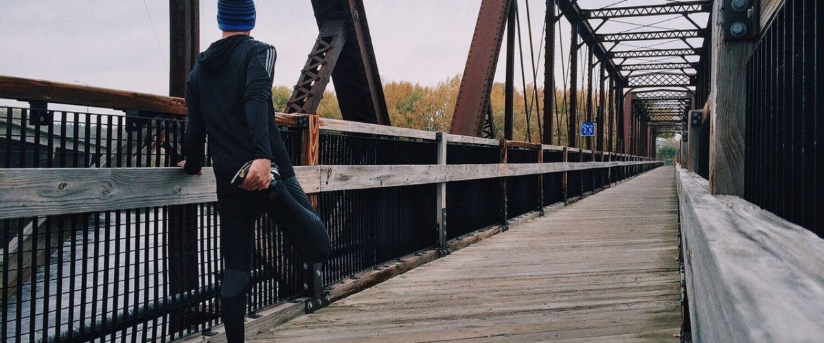 person jogging on a bridge