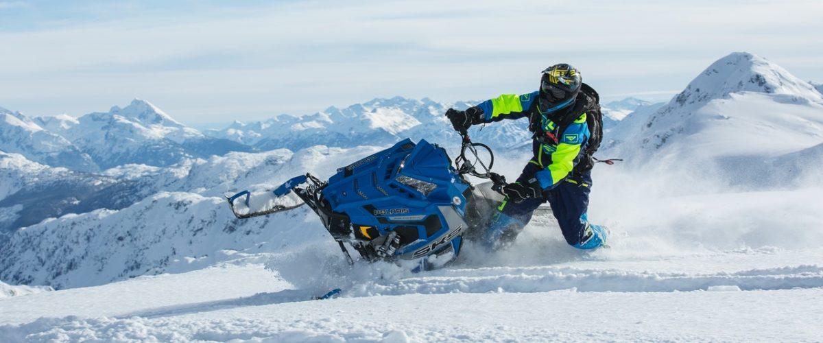 man riding snow ski